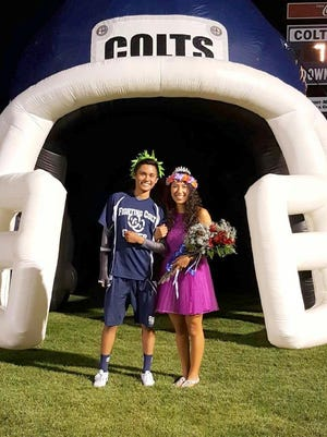Silver High Homecoming king Zach Valencia poses with queen Aleix Lopez during Friday's festivities at the Silver vs Cliint football game.