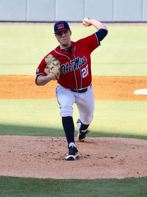 Ryan Rolison (22) exited Ole Miss' win over Texas A&M in the fifth inning after giving up three runs and four hits.