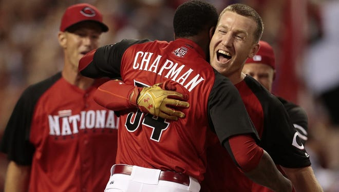 Aroldis Chapman runs to hug Todd Frazier as he wins the Home Run Derby on Monday.