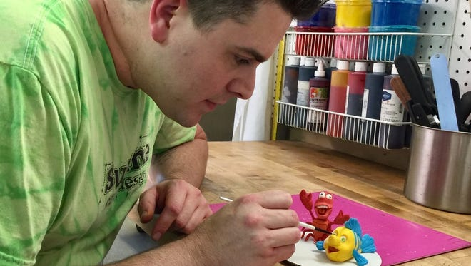 At Sublime Cake & Design, Wiley Saccheri creates cake decorations from modeling chocolate.