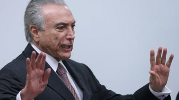 Brazil's acting President Michel Temer arrives to attend a meeting of ministers and military commanders on the preparations for the Rio 2016 Olympic Games.