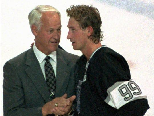 Wayne Gretzky is greeted by Gordie Howe after Gretzky