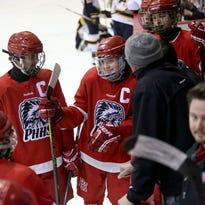 Port Huron players talk in a huddle during the Larry Manz Holiday Hockey Tournament Friday, November 27, 2015 at McMorran Arena.