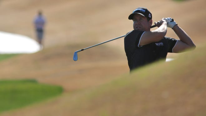 Erik Compton hits from the rough on the eighth fairway of the Nicklaus Private Course during the third round of the Humana Challenge on Saturday. Compton shot a 5-under 67 on Saturday is part of a four-way tie for the lead.