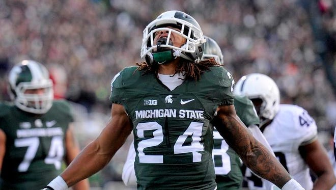 Running back Gerald Holmes yells out after scoring a touchdown in the second quarter against Penn State Saturday at Spartan Stadium in East Lansing.
