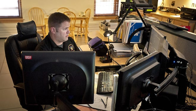 Dispatcher Howard Alden works in the call center at the Lamoille County Sheriff's Department in Hyde Park on Sept. 3, 2013. The department is one of several local and regional agencies that answer about one-quarter of Vermont's 911 calls, while the Department of Public Safety handles the rest.