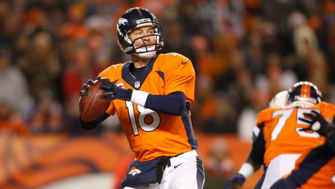 Denver Broncos quarterback Peyton Manning (18) looks to pass the ball during the first half against the San Diego Chargers at Sports Authority Field at Mile High.