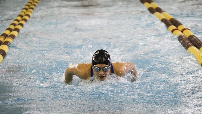 Okemos swimmer Freyja Garbaccio heads toward a first-place 200 yard IM championship win during the 2014 CAAC Blue Division championship finals at Holt. Garbaccio is a two-time LSJ swimmer of the year and is looking to earn it for a third time in 2016.