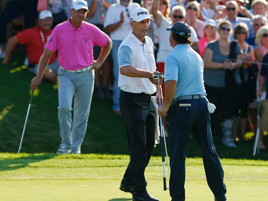 Kevin Sutherland, left, congratulates champion Scott McCarron after last year's Dick's Sporting Goods Open.