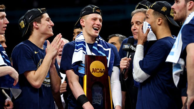 Apr 2, 2018; San Antonio, TX, USA; Villanova Wildcats guard Donte DiVincenzo (10) holds the National Championship trophy after beating the Michigan Wolverines in the championship game of the 2018 men's Final Four at Alamodome. Mandatory Credit: Bob Donnan-USA TODAY Sports ORG XMIT: USATSI-377823 ORIG FILE ID:  20180402_pjc_sd2_166.JPG