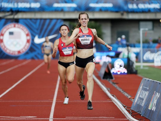 Molly Huddle crosses the finish line to place first