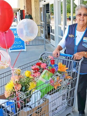 """Elaine Dyches retired from Walmart in Barnwell on July 10 after 35 years with the company. She started with Walmart in July 1985. She was sent off into her retirement with well-wishes and a cartful of gifts. """"Thank you to all my customers and co-workers! I love and miss you all, but definitely enjoying retirement,"""" said Dyches."""