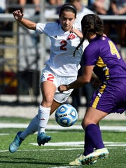 Jenna Zirkelbach of Mater Dei pushes the ball upfield against Megan Niehaus of Vincennes Rivet during the second half of the Class 1A Regional at Boots Baumann Field on October 14, 2016.