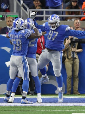 Detroit Lions' Tavon Wilson, center, celebrates his sack with Akeem Spence (97) and Tahir Whitehead against the Cleveland Browns, Sunday, Nov. 12, 2017 at Ford Field.