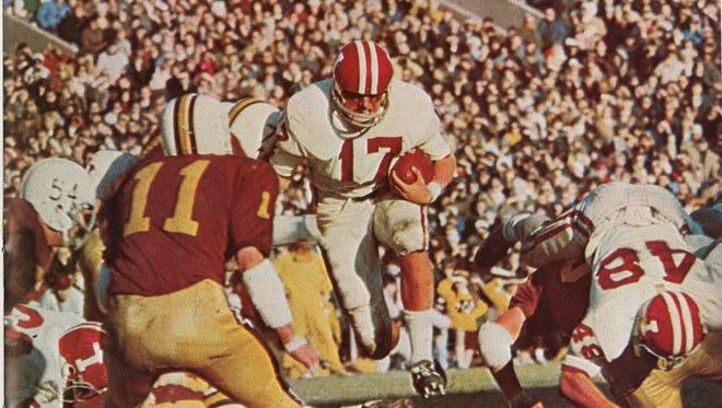John Isenbarger (17) runs up the middle against Minnesota in 1967.