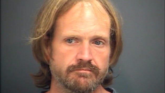 Thad J. McDaniel, pictured following his arrest in August 2014.