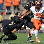 Illinois running back Ke'Shawn Vaughn, right, avoiding Purdue safety Robert Gregory during the Illini's win.