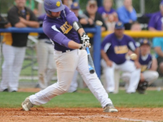 Hagerstown's Dylan Woolard swings at a pitch during the IHSAA Class A baseball regional semifinal at Carroll (Flora) Saturday, June 4, 2016.
