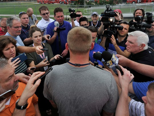 Penn State interim offensive coordinator Ricky Rahne is surrounded the by the media following the Nittany Lions' last practice at Fernandina Beach High School in Fernandina Beach, FL on Thursday, Dec. 31, 2015. The team is preparing to play Georgia in the TaxSlayer Bowl on Saturday, Jan. 2, 2015.