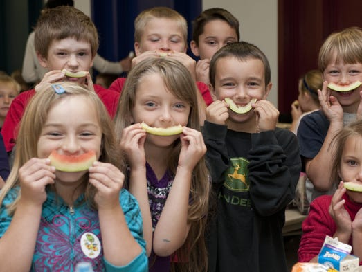 Students enjoy locally grown watermelon during the