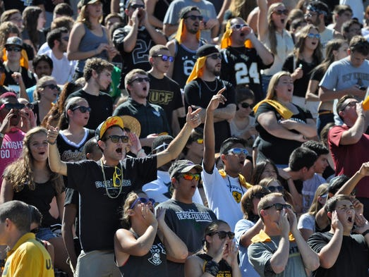 UCF fans shout in support of the Knights against Tulane.