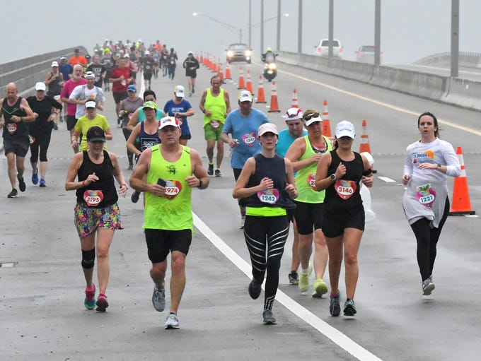 Runners on the Eau Gallie Causeway.The 2019 Publix