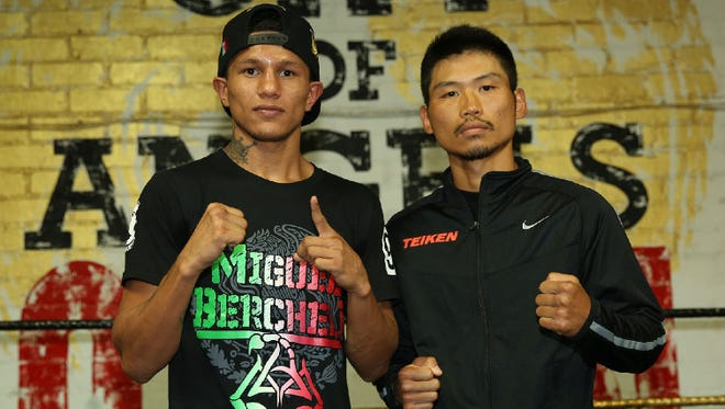 Miguel Berchelt, left, and Takashi Miura pose during a media workout this week in preparation for their title fight on Saturday.