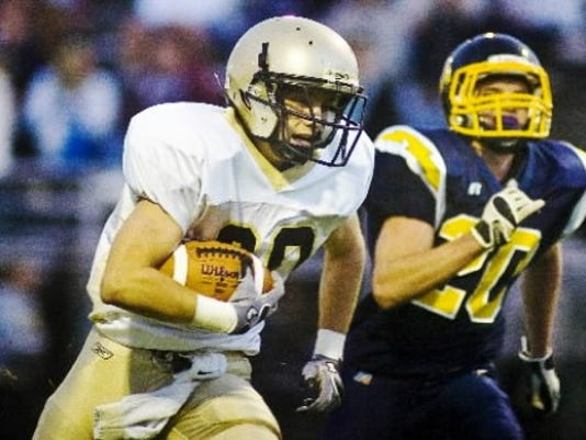 Cooper Ayres runs for one of his four receiving TDs against Littlestown.