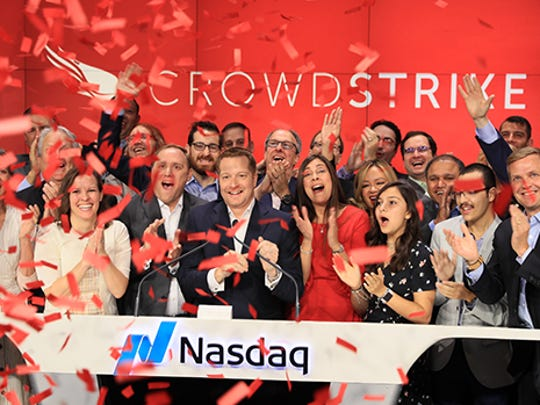 CrowdStrike employees celebrating CrowdStrike's first day on the Nasdaq.