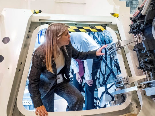 Dava Newman inspects the Orion space capsule