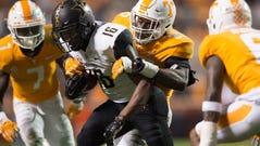 Tennessee linebacker Daniel Bituli (35) takes down