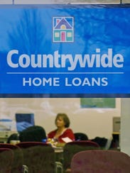 A Countrywide Financial Corp. worker sits inside a