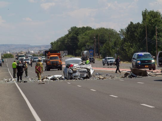 Emergency personnel work the scene of a car crash on