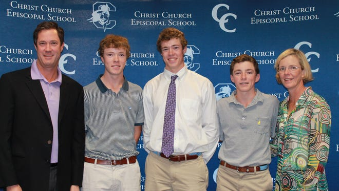 Christ Church senior Stephen Reynolds, center, signed to play golf at Furman University.