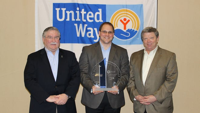 Jim Weishan, Todd Schroeder and Peter McPartland of Sentry Insurance accepted the Million Dollar Circle Award from United Way of Portage County for the company's raising $1 million during the 2015 campaign. The award was presented during the 2015 Recognition Luncheon Tuesday, Feb. 9, at the Holiday Inn in Stevens Point.
