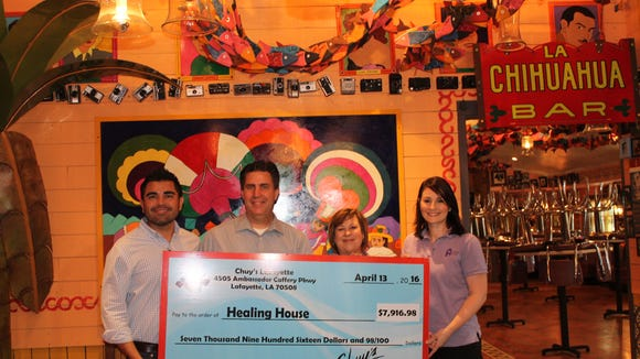 Chuy's recently presented a check for almost $8,000 to Healing House. Pictured, from left to right, are Chuy's area supervisor Fabian Alba, Chuy's local owner-operator Joel Docking, Healing House development director Kim Thackston and Healing House executive director Jenee Broussard.