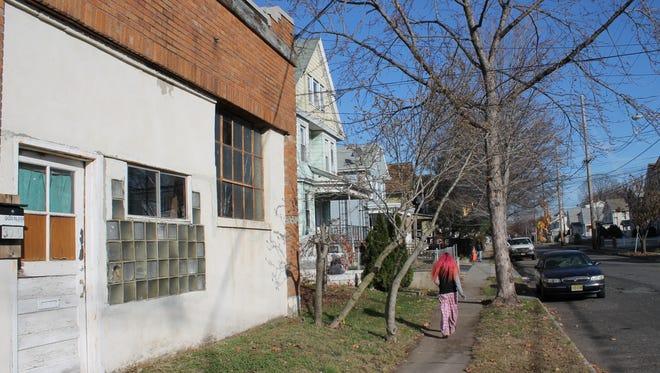 A Belleville resident walks on Cortland Street in December 2016.