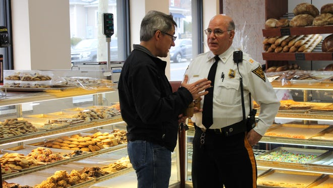 Resident Jeff Burdulis, left, chats with Nutley Police Capt. John Rhein in DaVinci Bakery during Coffee with a Cop.