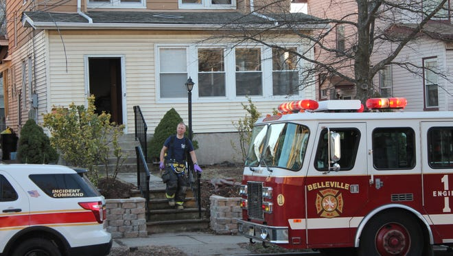 A Belleville firefighter exits a home at 179 Greylock Parkway Sunday, Feb. 19, 2017.