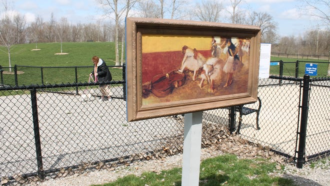 """Novi Dog Park features """"Dancers in a Green Room"""" by Edgar Degas."""