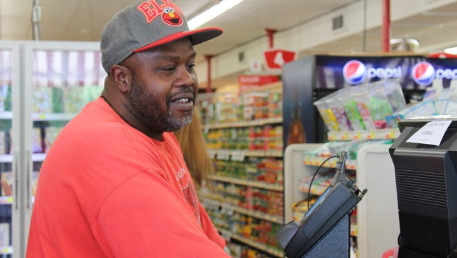 Thomas Jenkins was brought to tears Wednesday at Jr's Foodland in Murfreesboro when Redstone Federal Credit Union's Brightness Crew bought nearly $120 in groceries for his family.
