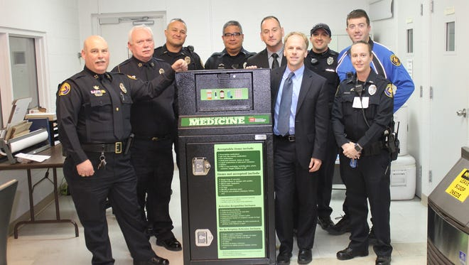 Chief Mickey Miller, Assistant Chief Jim Jones, Mayor Jamie Clary and several police officers announced the installation of the drug take-back box recently at the Hendersonville Police Building.