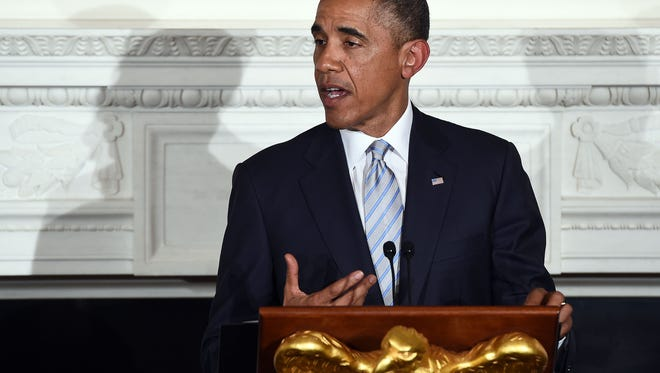 US President Barack Obama speaks as he hosts an Iftar dinner in the State Dinning Room at the White House in Washington on July 14, 2014. Obama said he hopes Egypt's ceasefire plan can restore calm in Gaza at the Iftar dinner, a fast-breaking meal for Muslim devotees during the holy month of Ramadan when the devout abstain from eating, drinking, smoking and any sexual activities from dawn to dusk.   AFP PHOTO/Jewel SamadJEWEL SAMAD/AFP/Getty Images ORIG FILE ID: 531645798