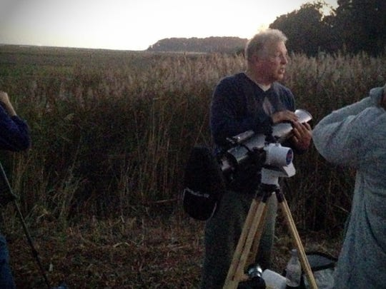 Gary Hand with his telescope at the NASA Wallops visitor's center before the Antares launch on Monday, Oct. 17, 2016.