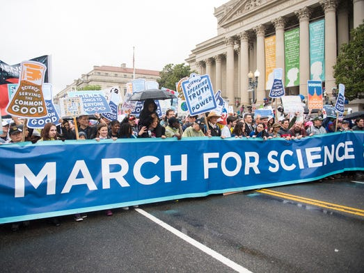 Marchers carry a banner at the head of the March for