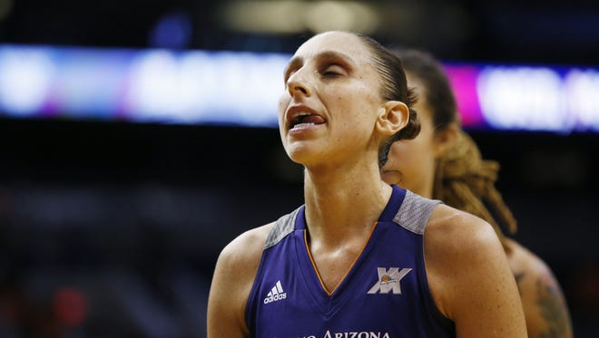 Phoenix Mercury's Diana Taurasi walks off the court dejected after losing to the Seattle Storm during the season opener in Phoenix, Ariz., on Friday, May 20, 2016.