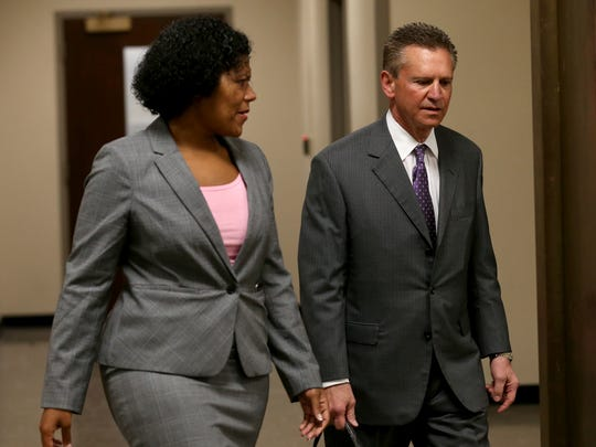 Rochester City Court Judge Leticia Astacio leaves court with her attorney, Ed Fiandach, at an earlier hearing
