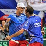 Tomas Berdych and Radek Stepanek celebrate after clinching the Davis Cup semifinal match against Argentina.