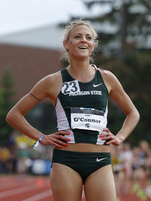 MSU's Leah O'Connor smiles after winning the 5,000-meter during the Big Ten Track and Field championship on May 17 in East Lansing. O'Connor will defend her NCAA title in the 3,000-meter steeplechase this week.