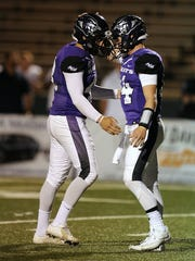 Thomas Metthe/Reporter-News Abilene Christian kicker Nik Grau (43) is congratulated by holder Parker McKenzie (14) after kicking a 21-yard field goal during the fourth quarter of the Wildcats' 55-52 loss on Saturday, Sept. 10, 2016, at Shotwell Stadium.